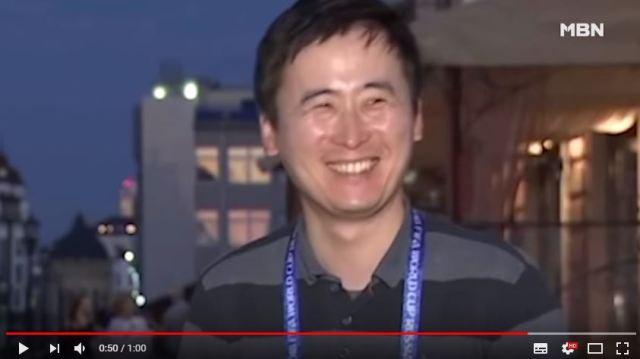 【W杯の裏側】現地レポート中に放送事故!「まさかの奇襲」を受けた韓国キャスターの表情がこちらです